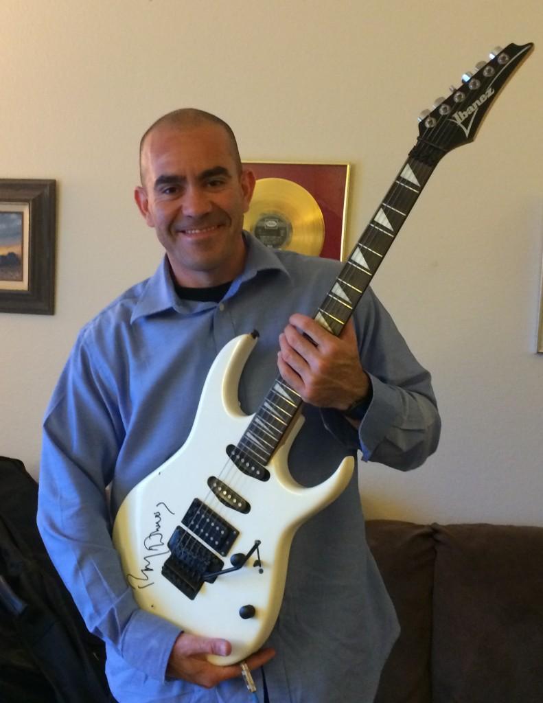 Joel Solis, Award Winner of Ray Davies Signed Guitar.
