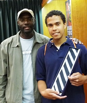 Antwone Fisher with the young man, Marcus, who won a TIE at Vroman's